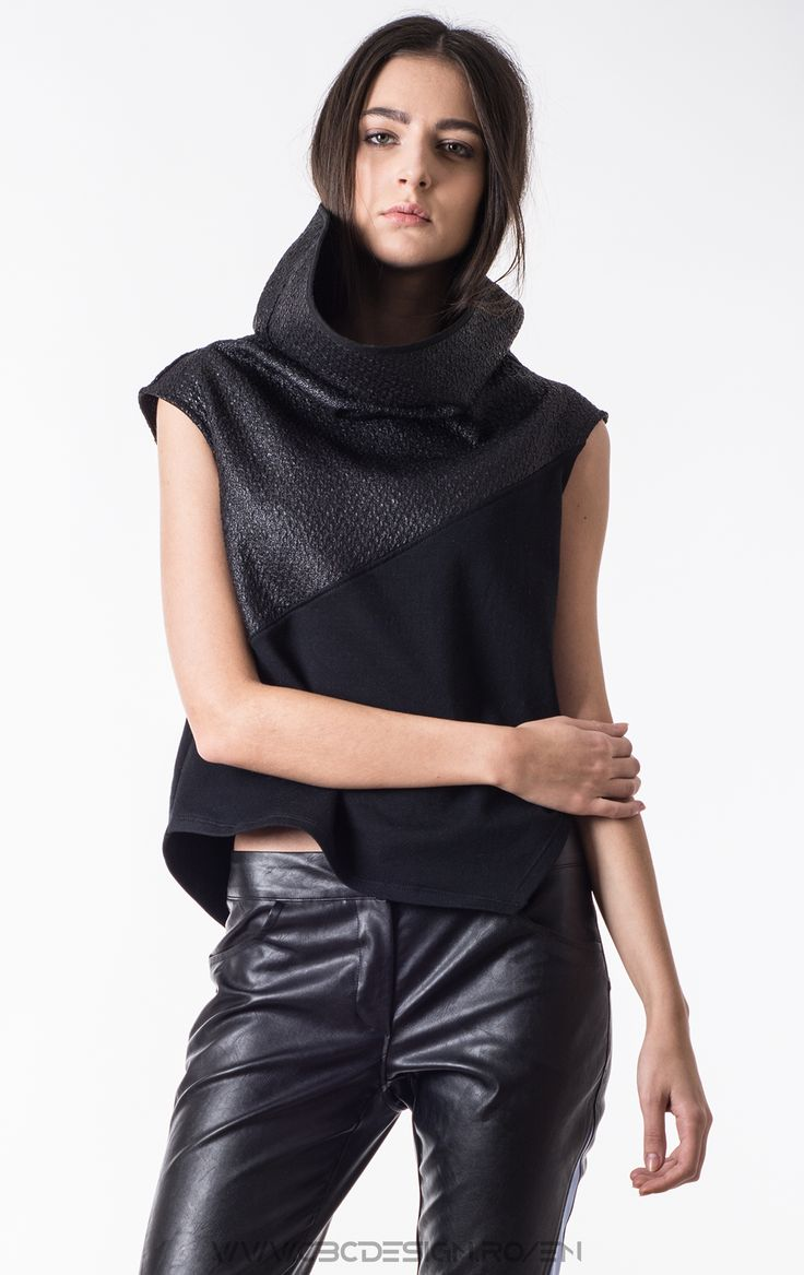 Sleeveless top from fleece jersey with exaggerated collar from coated fabric with gravel-like texture.  The too is warm and soft due to its fabric (cotton fleece) . Althought the sectioned design has a chic-sport and casual personality,  neutral color is very wearable and offers infinite styling possibilities.