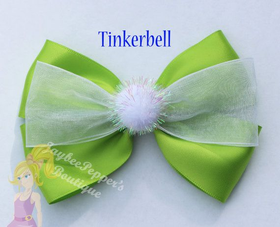 Tinker bell inspired hair bow. Measures about 4.5 across All bows are made in a smoke free environment and the ends of the bows are heat sealed to