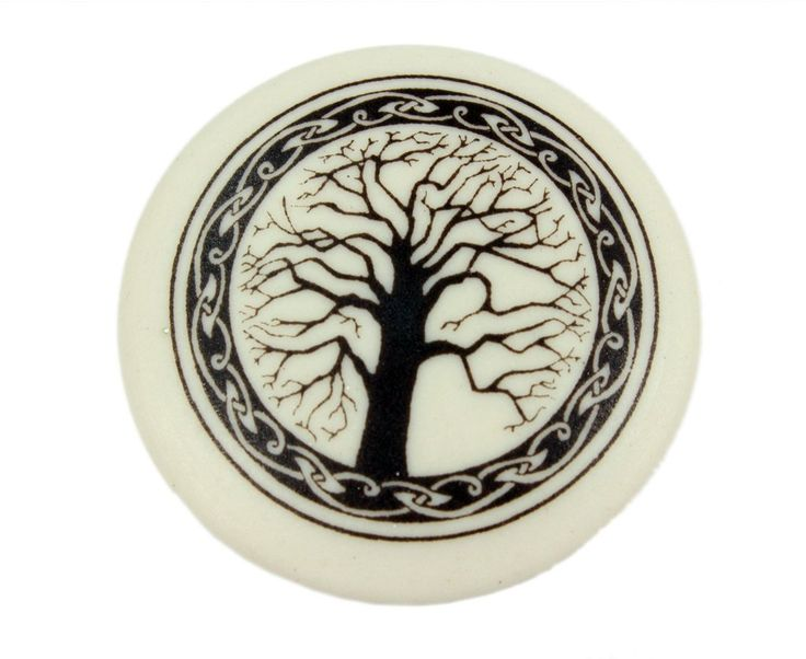 """This beautiful round brooch features the traditional Irish symbol that signifies spiritual growth, abundance and rebirth. The brooch also comes with an informational card describing the Tree of Life meaning!t The brooch is crafted from porcelain clay and measures approximately 1"""" in diameter. It is connected to a long pin to secure to your clothing. These porcelain clay pieces like this Tree of Life pin were originally developed in Scotland over 25 years ago"""