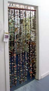 Hippie beaded doorway curtain, made of bead & chunks of broken skate boards on wire