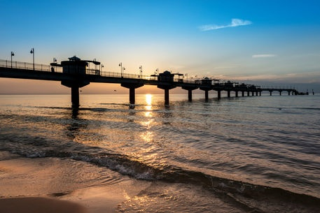 'Sundown over Miedzyzdroje pier' by Jacek Kadaj on artflakes.com as poster or art print $18.71