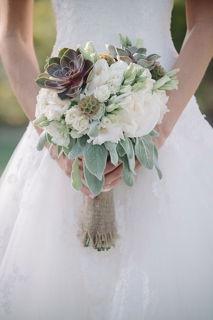 Gorgeous wedding bouquet with white flowers and green succulents
