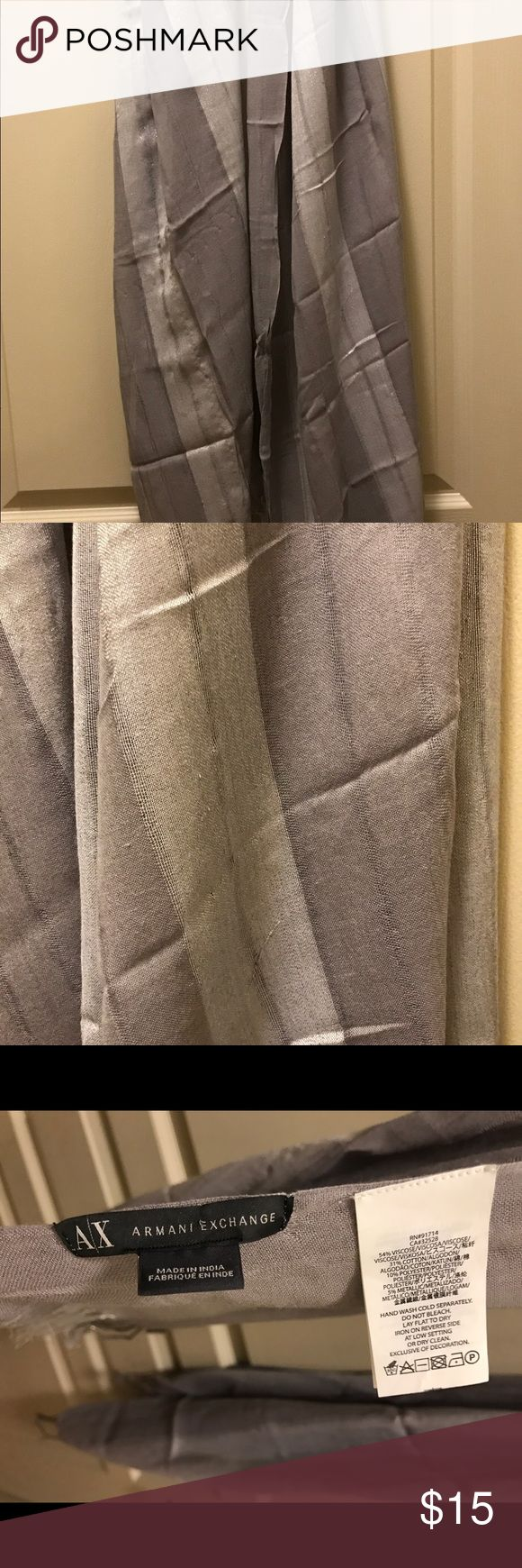 ARMANI EXCHANGE LIGHT WEIGHT GRAY & SILVER SCARF This is a really cute scarf!  Only worn a few times. Clean, smoke free and animal free home. Check out what else I am selling. Thanks for looking :) A/X Armani Exchange Accessories Scarves & Wraps