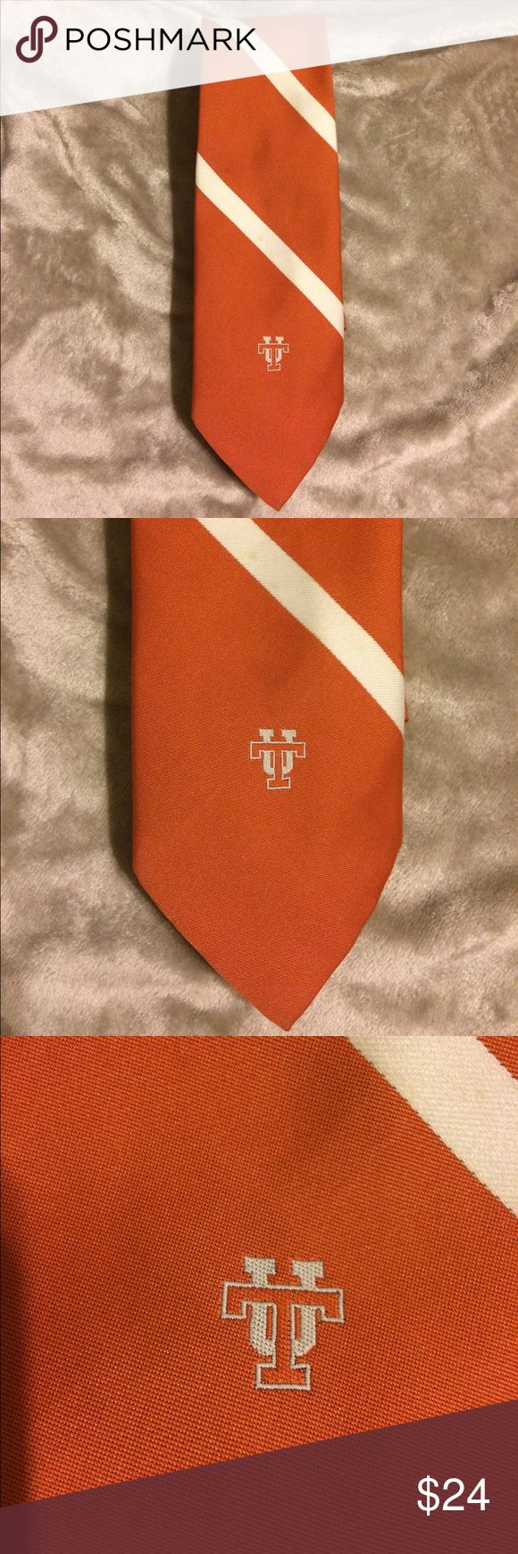 University of Tennessee neck tie London 400 EUC Beautiful neck tie by London 400 By Cambridge Apparel Baltimore, MD. Collegiate Licensing Company. Orange & white with the UT at the bottom. Excellent condition. I live to bundle and have more ties listed as well as another UT tie that plays Rocky Top.  Bin Z London 400 Accessories Ties