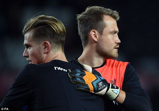 Mignolet (right) congratulated Karius after the tie but knows the German goalkeeper wants his starting position