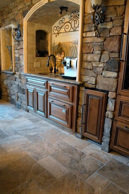 Stone wall, niche and arch-   idea of what the built in buffet could look like with stone