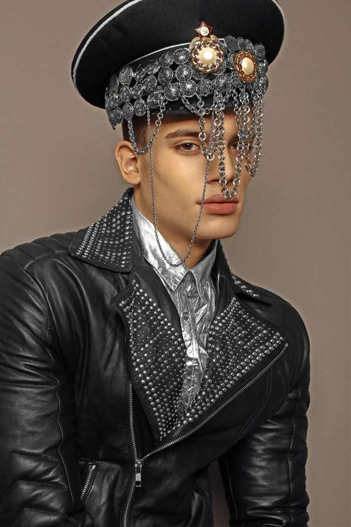 Uros wears hat, jewelry, jacket Versace and shirt Acne.