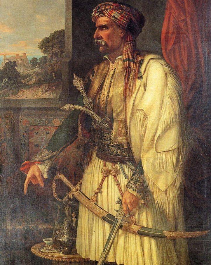 Αγνώστου ζωγράφου, Προσωπογραφία έλληνα αγωνιστή, ελαιογραφία. H αγέρωχη και ρωμαλέα μορφή με την πλούσια ενδυμασία, την κάπα και τα πολυτελή όπλα, πρέπει να αποδίδει κάποιον σημαντικό στρατιωτικό ηγέτη, πιθανότατα τον Θεόδωρο Κολοκοτρώνη ή τον Νικηταρά. 2,40 x 1,20 μ. (ΓΕ 9015)