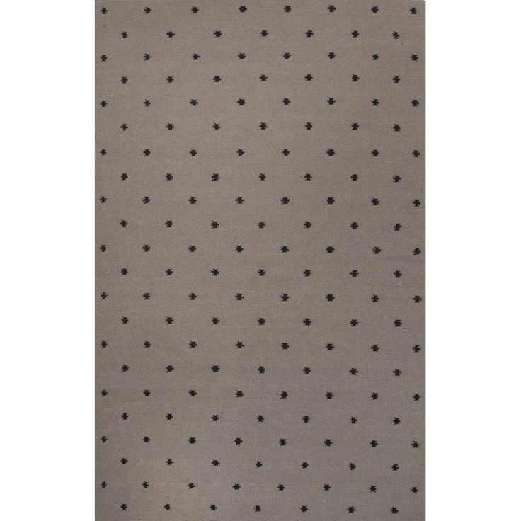 A graceful accent to a traditional or transitional decor, this wool rug's Swiss dot effect is created with spots of black on a grey ground. The flat-weave design makes it easy to care for and reverses to yield bonus wear.
