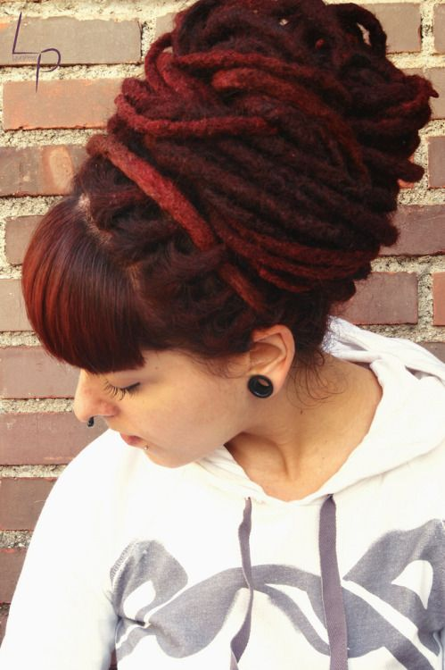 This burgundy beehive is both eye-catching and elegent