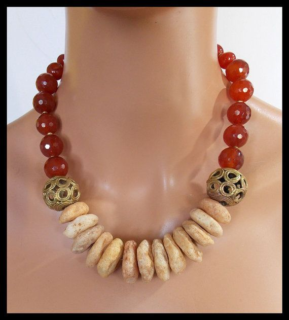 SOLD....but I can make another. A piece of African history.....handcarved quartz discs from Togo dating to 1800s. I have also used handmade African brass beads and a combination of faceted and hand cut off round Carnelian beads in this unique and historical necklace. Fastens with my signature, large, fancy handforged bronze clasp and soldered link brass chain. Adj from about 20 -22 inches.