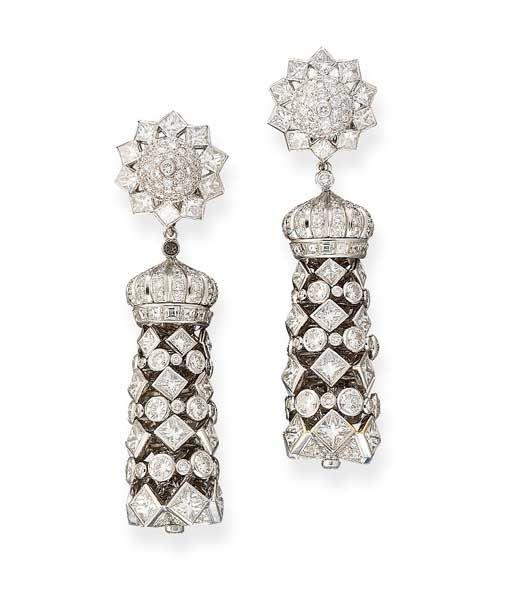 A PAIR OF DIAMOND EAR PENDANTS, BY GRAFF  Each designed as a detachable tassel of graduated princess and brilliant-cut diamonds with crown-shaped cap, to the diamond star-shaped surmoun