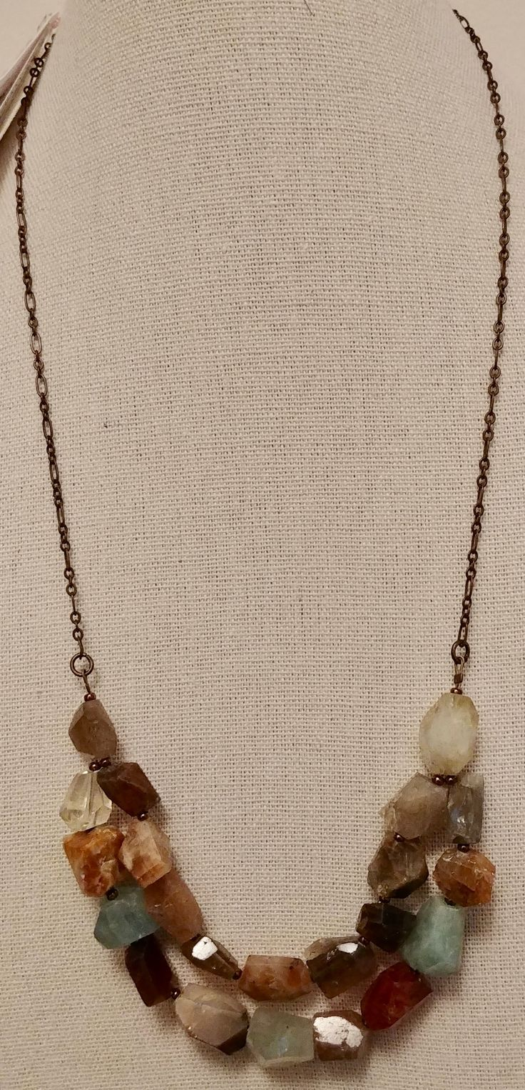 Mixed Faceted Semi-Precious Stone Nuggets on a bronze tone chain.