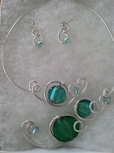 Here is an unique set of jewelry. A modern open collar necklace and earings, made with glass beads and silver aluminium wire.  You just have to place it on your neck no need to attach it.  It's one of