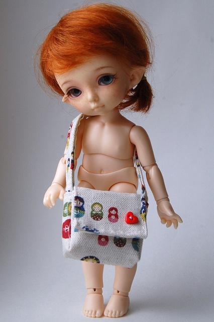 cute doll, cute bag with button. :)