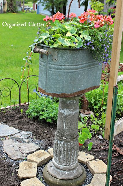 Adding vertical junk interest to your garden, by Organized Clutter, featured on Funky Junk Interiors
