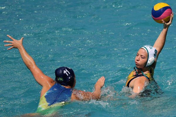 Mariana Duarte Photos Photos - Zoe Arancini #9 of Australia passes over Mariana Duarte #11 of Brazil during the Womens Preliminaries on Day 8 of the Rio 2016 Olympic Games on August 13, 2016 in Rio de Janeiro, Brazil. - Water Polo - Olympics: Day 8