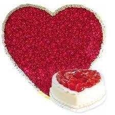 A Hamper Of 100 Heart shaped roses 1 kg cake.
