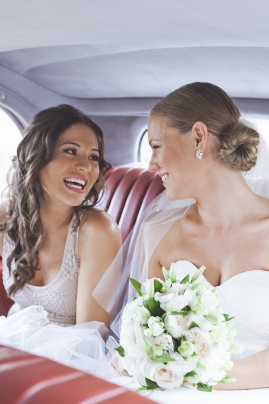 """A beautiful bride and her bridesmaid in our wedding car 'Dolly"""""""