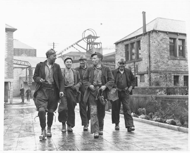 Miners on way to the pithead baths after a shift at Ashington (New Moor) Colliery in Northumberland