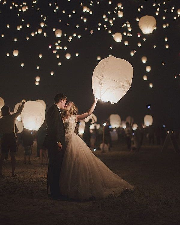 Sky lanterns make a magical wedding send off - and a pretty beautiful portrait too! Seen on @swoonedmag | Photography: @_beyond_the_darkroom_ | Brides Dress: @allurebridals by aislesociety