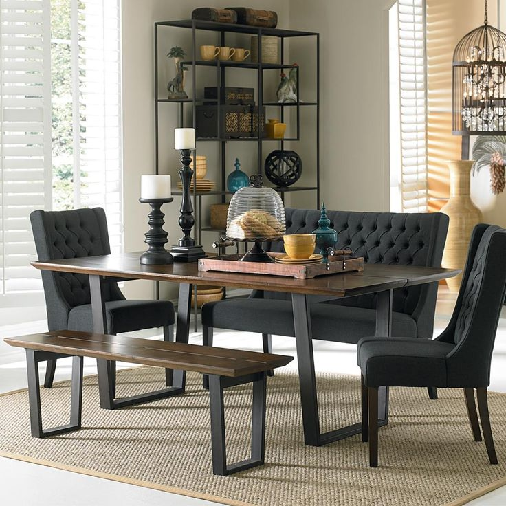 Contemporary design blends with old world style in our Mozambique collection. Each artisan-crafted piece combines a strong iron base with a solid Acacia wood top to create a sleek and durable table. T