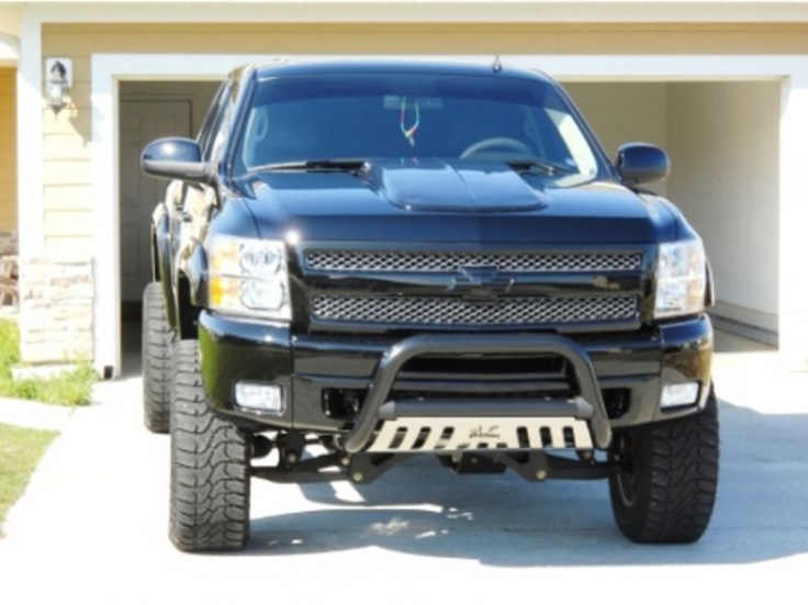 Honey ... I'm afraid it's not going to fit into the garage.  2011 Chevy Silverado lifted 4x4 truck