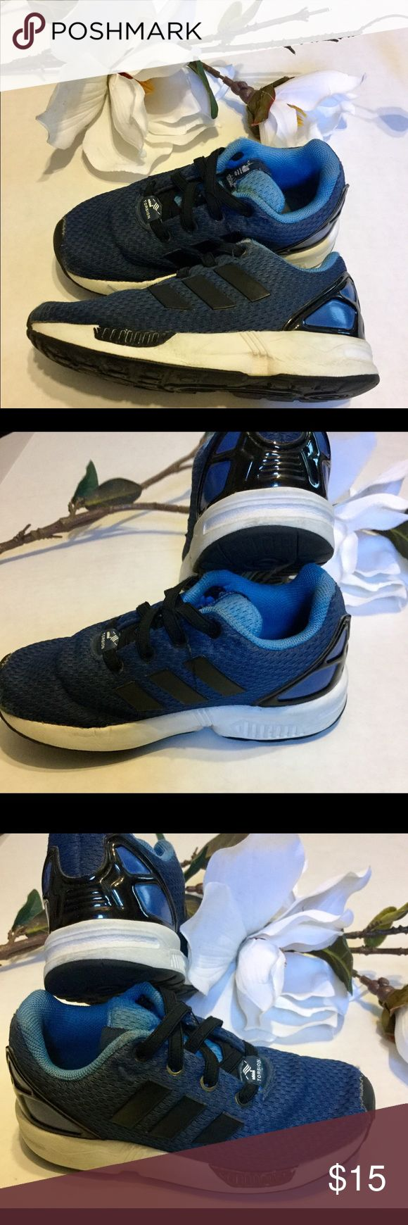 ⚜️Adidas Torsion Zflux Sneakers 9c⚜️ Adidas 9c Torsion ZX Flux no tie sneakers⚜️blue and black with black patent accents⚜️Flaws stain on tongue (see pics) minor signs of wear-but still in good conditions⚜️Please review all pics before purchasing adidas Shoes Sneakers