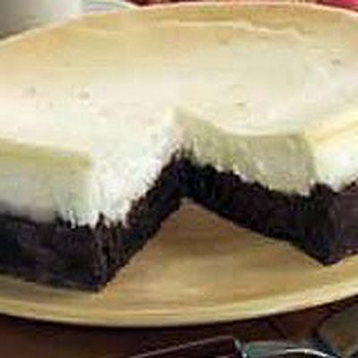 PREHEAT oven to 350°F. Prepare brownie batter as directed on package; pour into greased spring-form pan. Bake until top of brownie is shiny and center ...