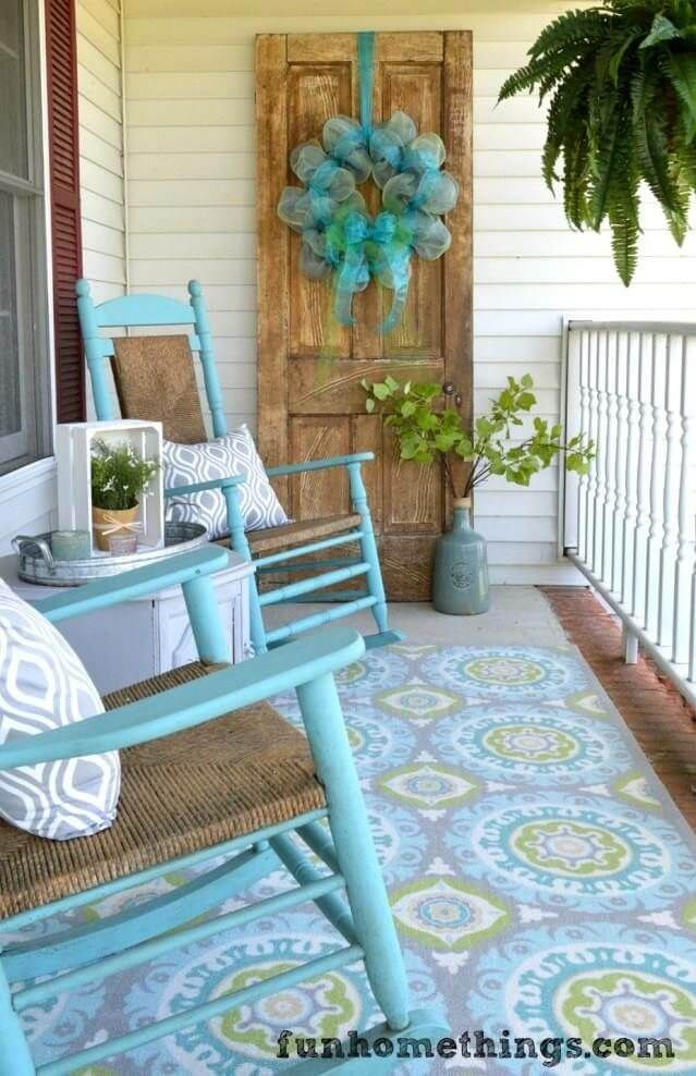Turquoise Rocking Chairs, Patterned Rug, Billowy Wreath