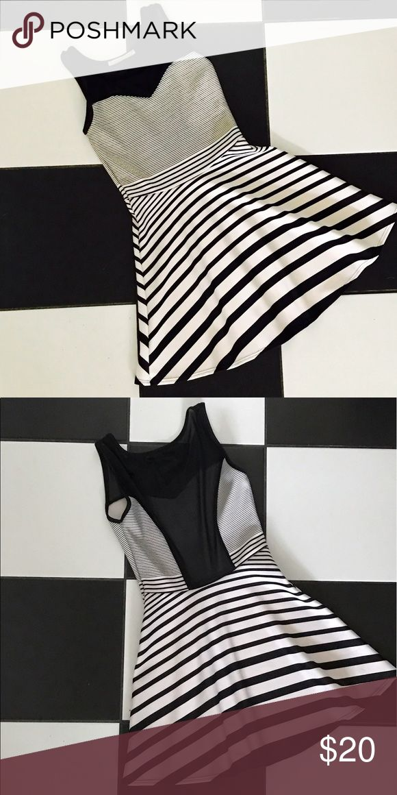 Black and White Dress Fun and flirty with sweetheart design/upper mesh top and open mesh back. Worn once. Great for any occasion! Dresses Mini
