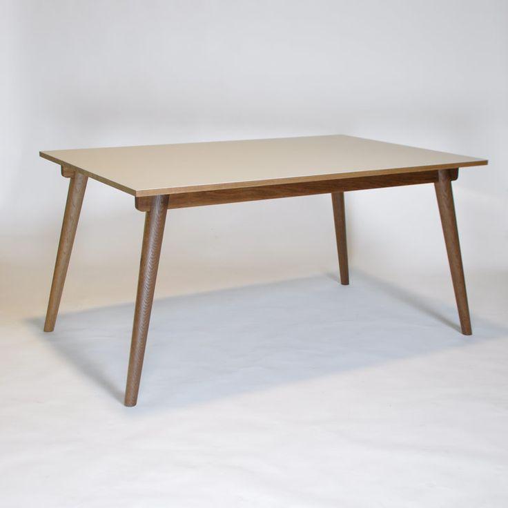 Facile and elegant table made of smoked oak and linoleum. http://www.kjeldtoft.com/