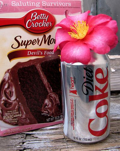 """Diet Coke Cupcake   One diet coke cupcake with a spoonful of Cool Whip """"lite"""" is less than 100 calories (3 points on Weight Watchers).    You can also try a white cake mix with one12oz. can of sugar free Cherry 7up. The cupcakes come out of the oven fluffy, taste good and have a lot less calories."""
