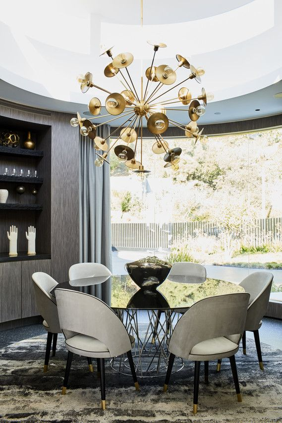 The dining room of a home in Beverly Hills. The home has strong modern elements with contemporary touches.