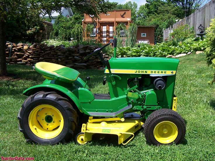 This is a John Deere 110.  The 110 was Deere's first entree for the lawn tractor market.  Unlike many lawn tractors today, the 110 could be setup to pull a single-bottom plow.