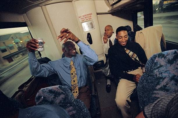Basketball Portrait of Chicago Bulls Michael Jordan Ron Harper and Scottie Pippen riding team bus smoking cigars and drinking beer Houston TX 4/5/1998