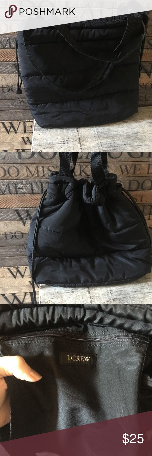 J Crew Puffer tote bag purse black fleece lined This is a like new tote purse by j crew. It is black in color and has draw string to cinch closed if desired. Has one pocket that zips on the inside. The inside is lined with fleece! Smoke free J. Crew Bags