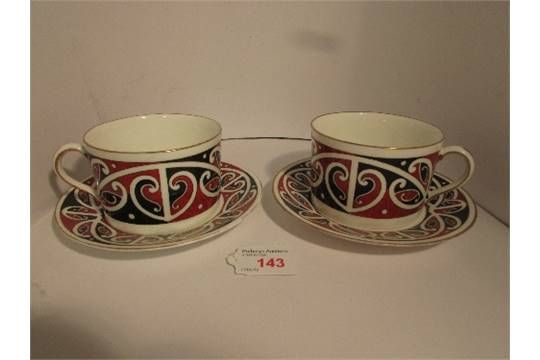 Two Royal Doulton 'Maori Art' cups and saucers, red and black…