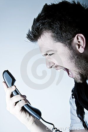 Man shouting on the phone by Engin Korkmaz, via Dreamstime