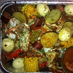 Garlic Blue Crab with potatoes, eggs sausage and corn Recipe