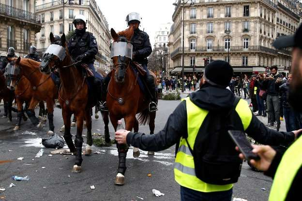 French Mounted Police Advance During Clashes With Protesters Wearing Yellow Vests At A Demonstration Stephane Mahe Reute Yellow Vest Gilets Winter Jackets