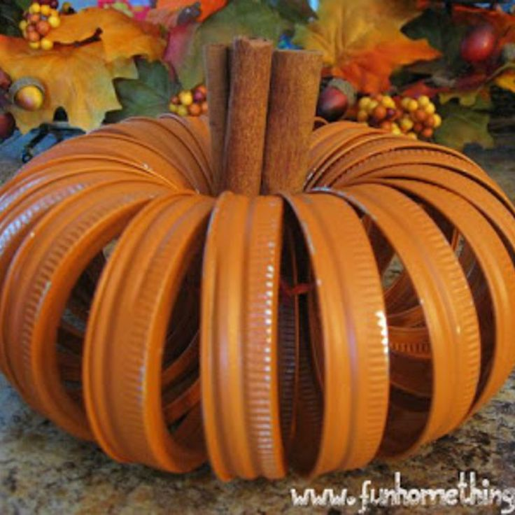 Canning Lid Pumpkin so cute and probably smells delicious with those cinnamon sticks!