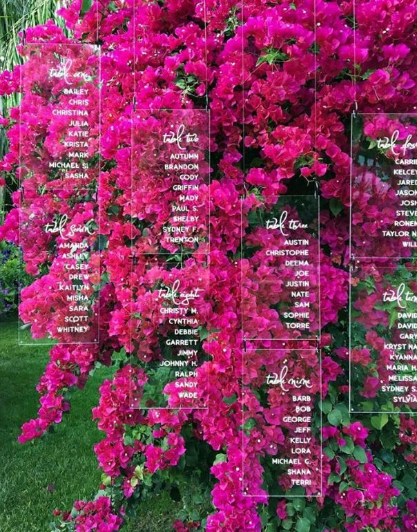 How breathtaking is this display of seating assignments for a wedding? I adore bougainvillea. How clever to place clear acrylic signs in front of the bright pink so that the gorgeous color shines through