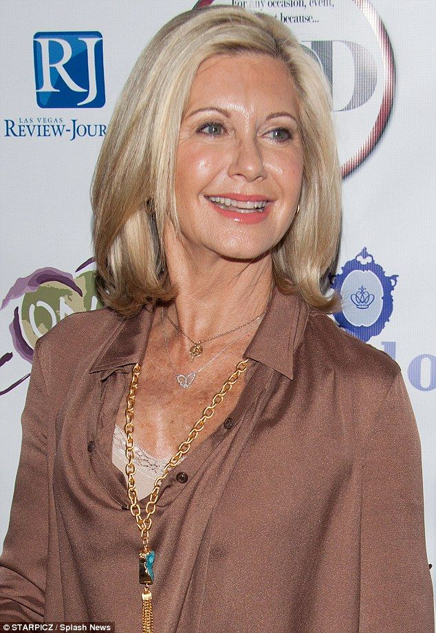 Olivia Newton-John, age 65, at an awards ceremony in Las Vegas. THIS ladies, is how you age gracefully!!