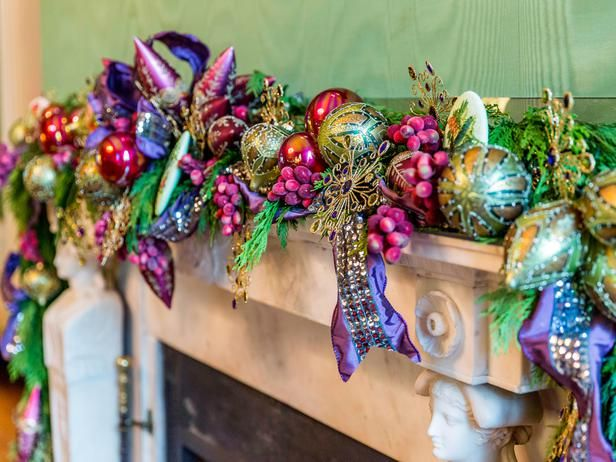 White House Green Room~Full, fresh greenery decorated with jewel-toned ornaments, plum ribbon and sugared fruits dress up the room's mantelpiece.
