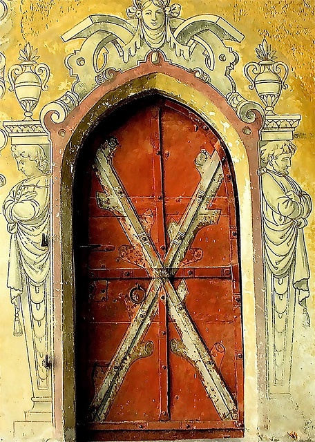 """Interesting ancient door. The """"X""""m and the arm positions of the man and woman.  Wonder what it means?"""