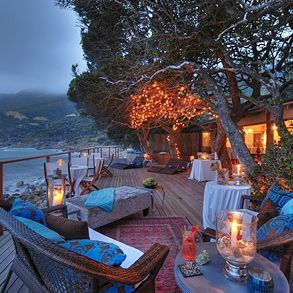 "Tintswalo Atlantic / Cape Town, South Africa ""In the base of a cliff top just outside of Cape Town overlooking the Atlantic in a cove — a relaxed base to explore the area. The wooden and glass property blends sympathetically into the surroundings — and what surroundings..."" http://www.whatsworthit.com/places-to-stay/tintswalo-atlantic/"