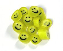 Mango flavored yellow candy - and just look at that happy smiley face!