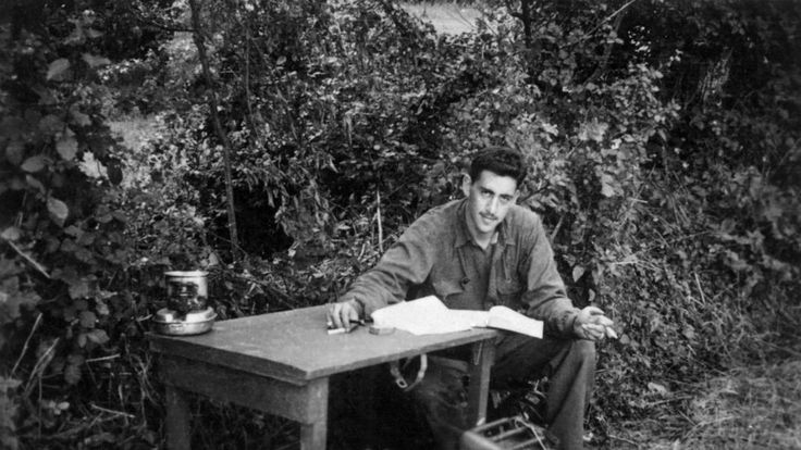 """This is the only photo in existence of J.D. Salinger writing """"Catcher in the Rye"""". Taken during WWII."""