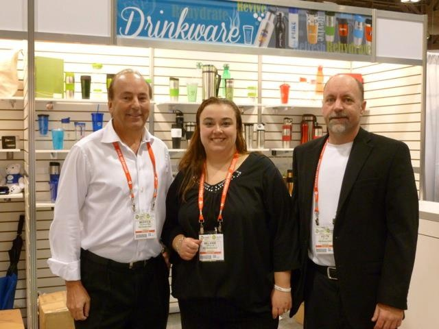 Merrick Falkenstein, President and CEO, Melanie Langille, Customer Service Manager, and Keith Addis, VP of Sales, at the Toronto trade show